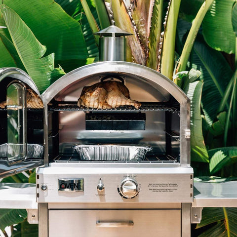 Summerset Freestanding Outdoor Gas Pizza Oven Cooking Whole Chicken with Door Open in Backyard