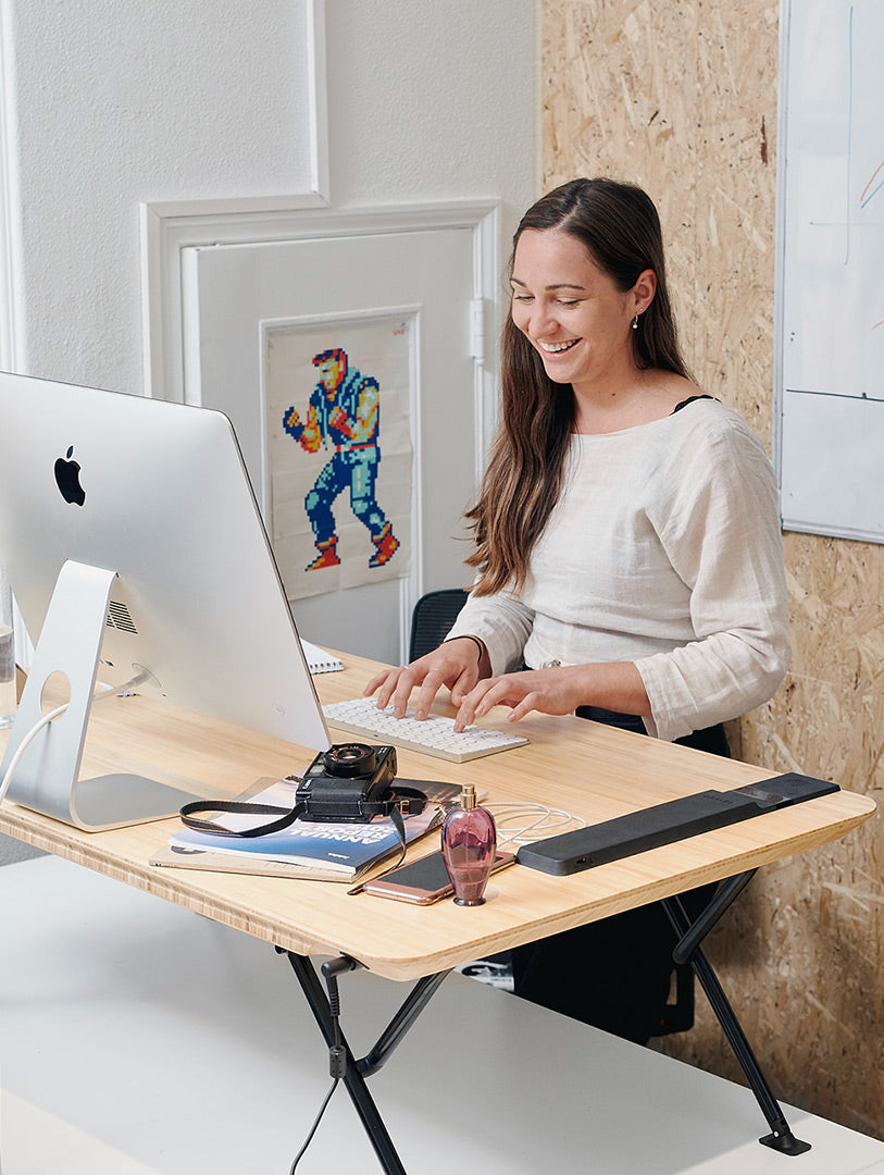 woman using standing desk