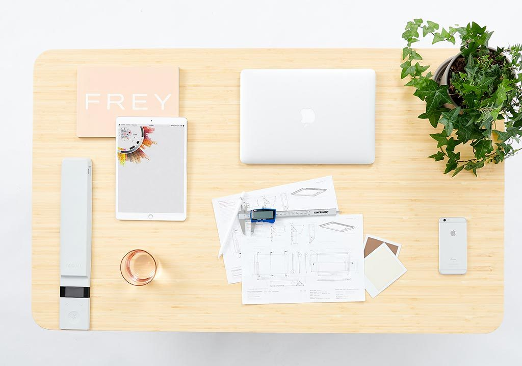 White | desk with laptop, flowers and notes