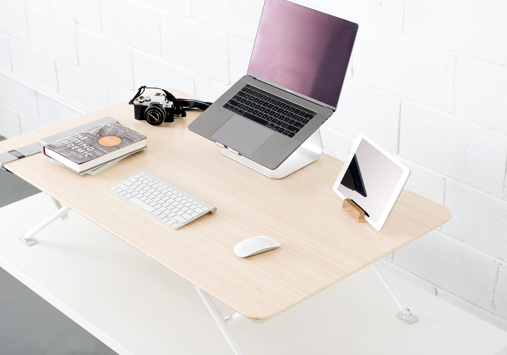 White | laptop, ipad and book on standing desk