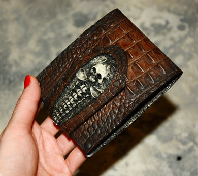 Leather wallet with skulls . Cow leather with crocodile embossing . Brown color.