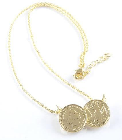 Two coin necklace where the two gold coins are side by side as the main pendant. The coins hand on a gold sparkling chain.