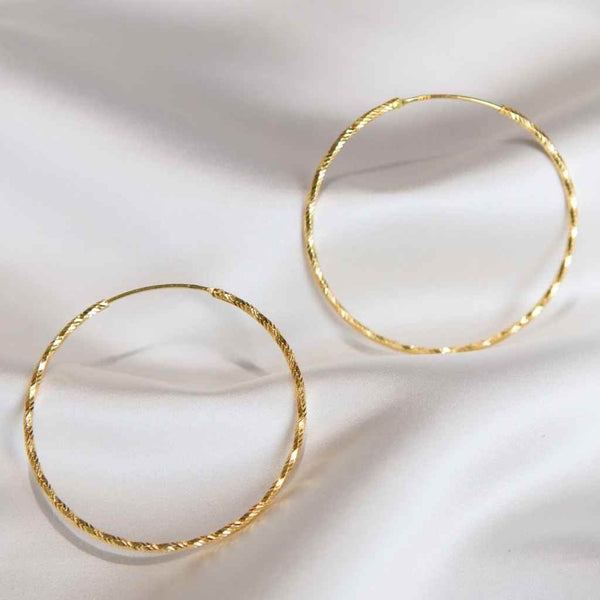 Big hoop earrings high shine finish continuous fastener.