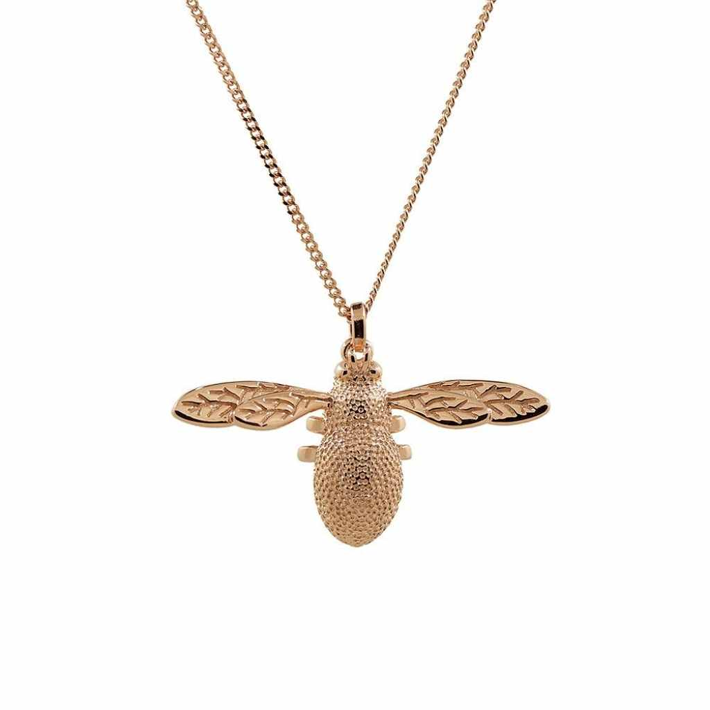 Three dimensional rose gold bee necklace with intricate detail.