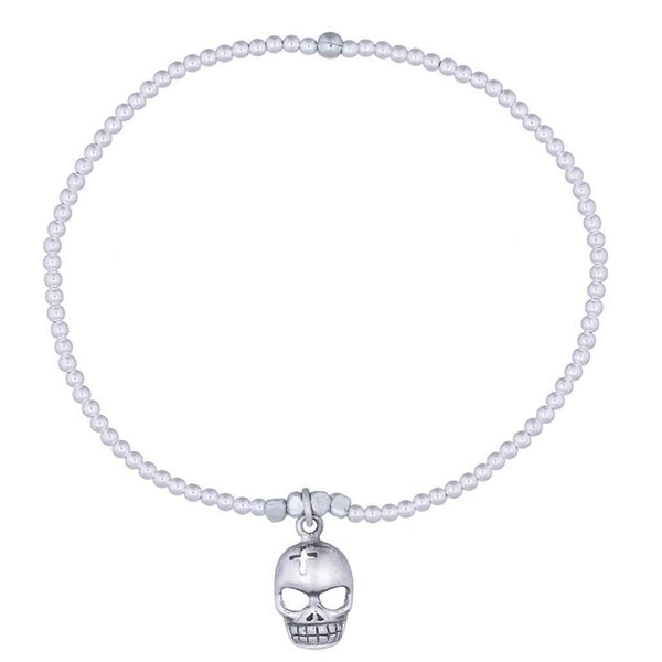 Skull charm in sterling silver on a bead stretch bracelet.