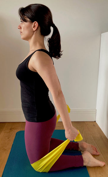 Pilates arm extension with resistance band