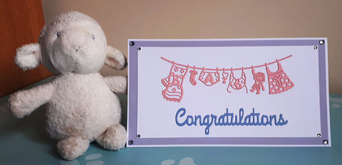 Congratulations on your baby card using die cuts and double sided adhesive sheets