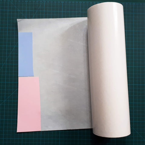 Place your card on to double sided adhesive sheet Sticky Roll