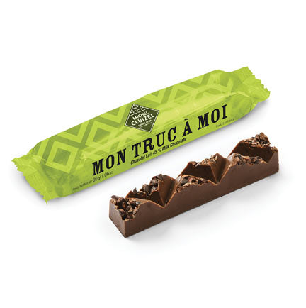 Gourmet mini milk chocolate bar with cocoa nibs, nougatine, & hazelnut paste.