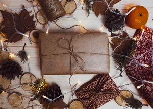Present wrapped in brown paper with festive decorations