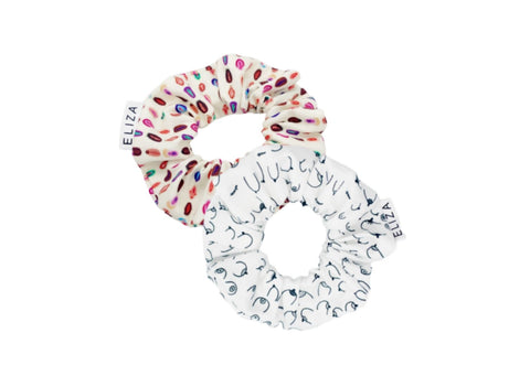 2 organic cotton scrunchies on top of each other, one colourful and one black and white