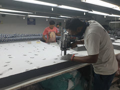 Blocks of fabric being cut