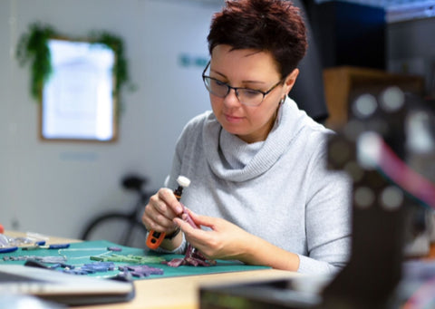 Jay from YagoEco making recycled plastic earrings in her London studio
