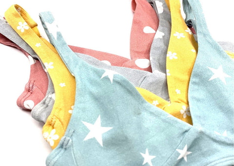 Y.O.U Underwear's 4 fun patterned girls' Bralettes. Blue on top, then yellow, grey and pink