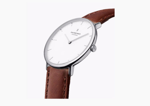 Nordgreen minimal watch with a vegan brown leather strap and a silver clock face