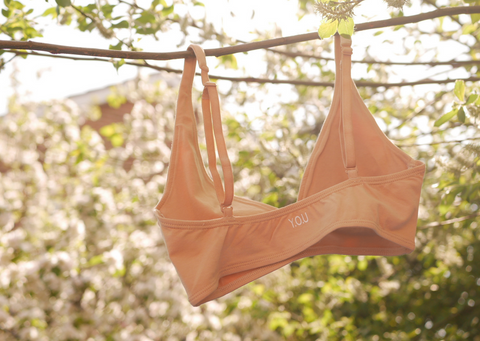 Bralette hanging from a branch