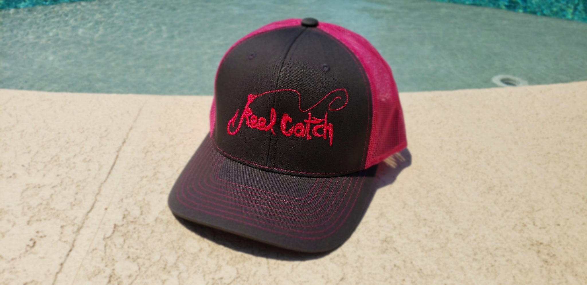 Charcoal with neon pink trucker
