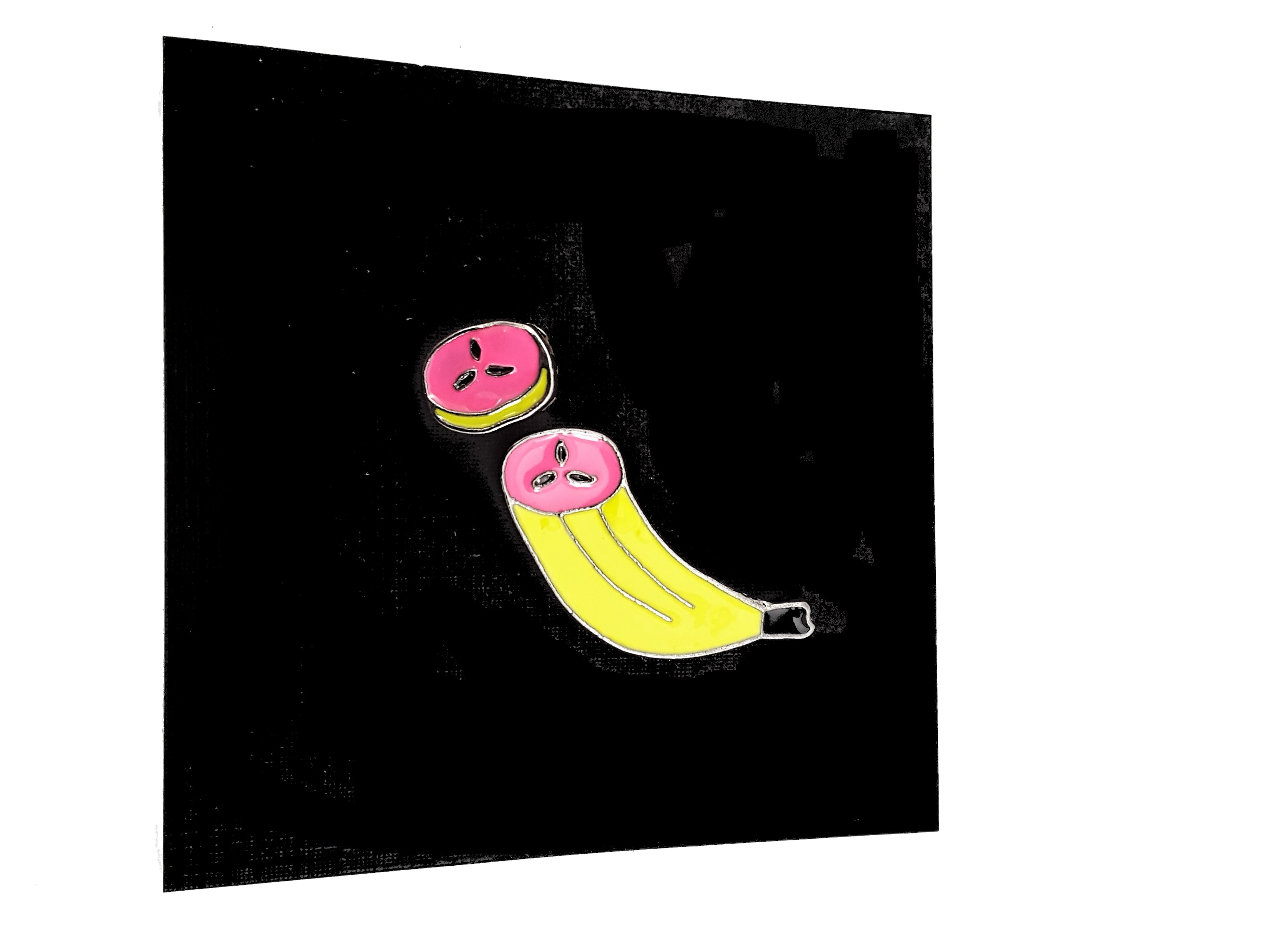 BANANA 2-PIECE ENAMEL PIN SET ON BLACK BACKGROUND