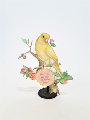 3d canary perched on a flowering branch greeting card