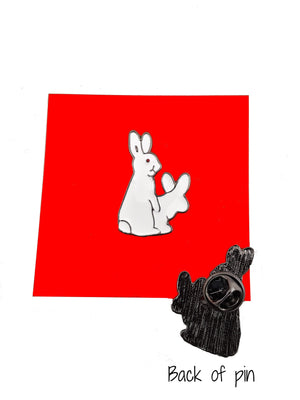 CUTE BUNNY LOVE ENAMEL PIN ON RED BACKGROUND