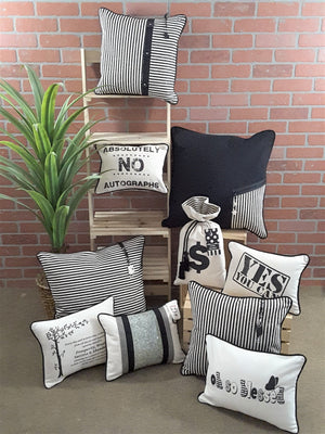 Collection of black and natural pillows by Alexanndra Carington