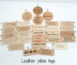 ASSORTMENT OF HANGING LEATHER PILLOW TAGS