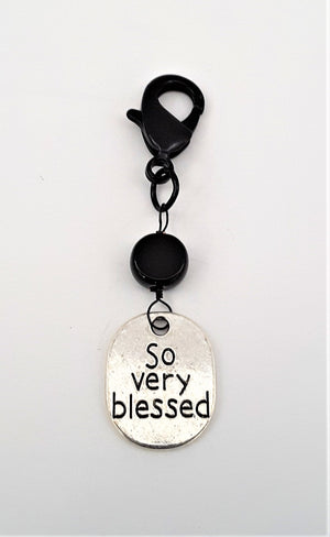 So Very Blessed antique silver charm that comes with the black denim zippered pillow