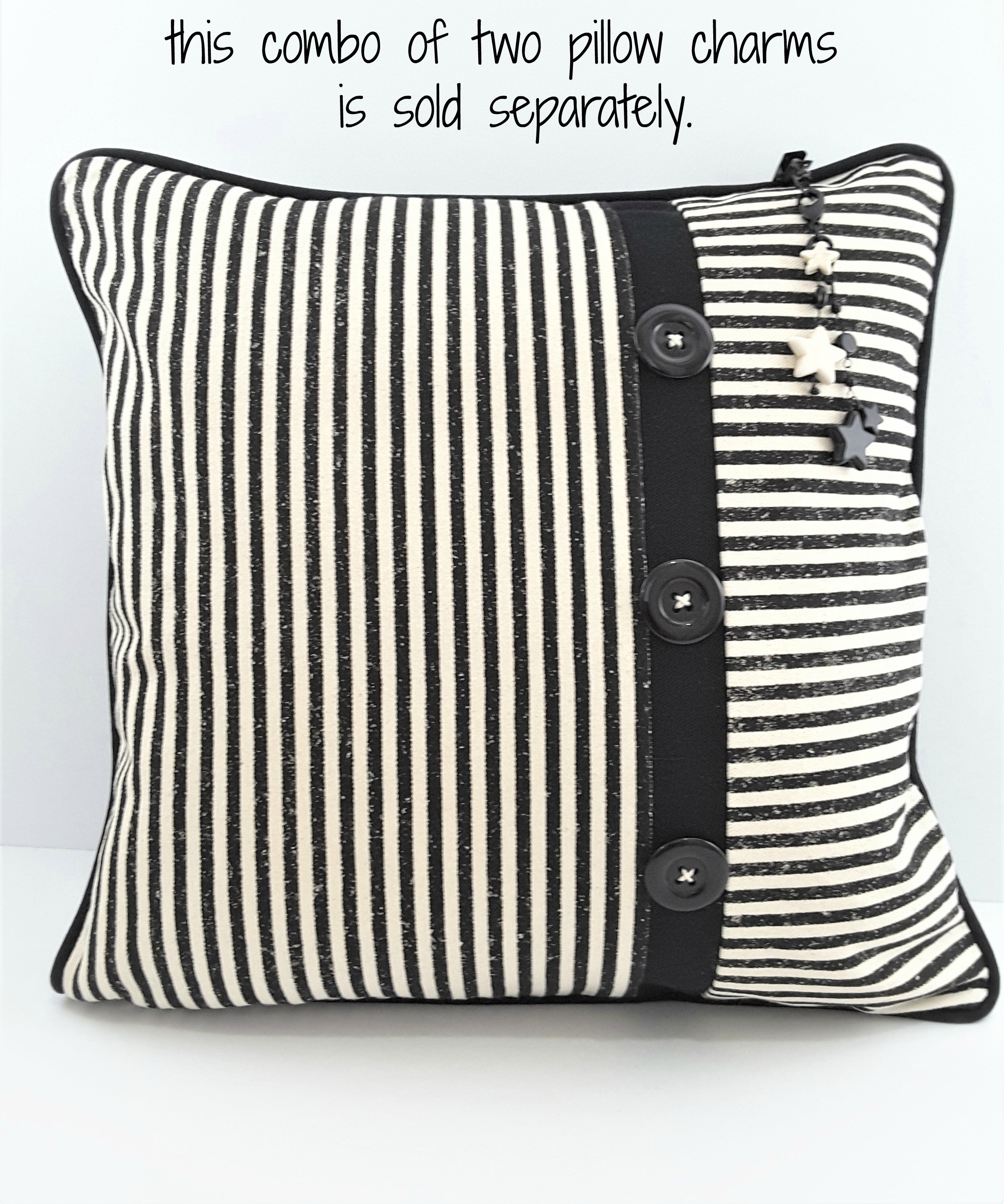 TWO PILLOW CHARMS HANGING FROM STRIPE, 3 BUTTON PILLOW