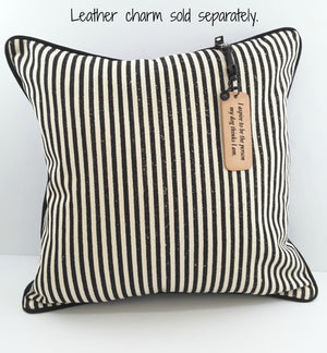 HANGING LEATHER PILLOW TAG ON STRIPE PILLOW