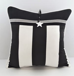 WHITE STAR CHARM HANGING FROM WIDE STRIPE PILLOW