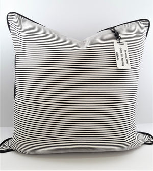 WHITE PRINTED PILLOW TAG ON NARROW STRIPE PILLOW