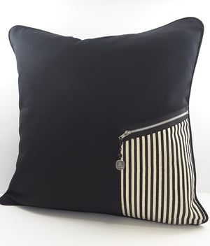 black denim pillow with black & natural striped zippered pocket & charm