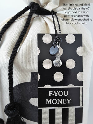 close up of tag on Prosperity Money Bag Pillow