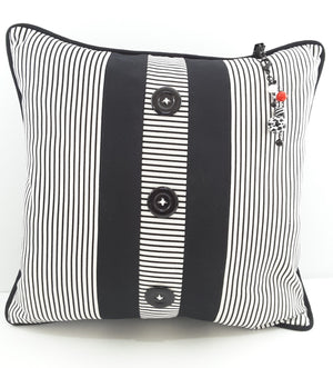 3-STRAND BEADED PILLOW CHARM HANGING FROM STRIPE PILLOW