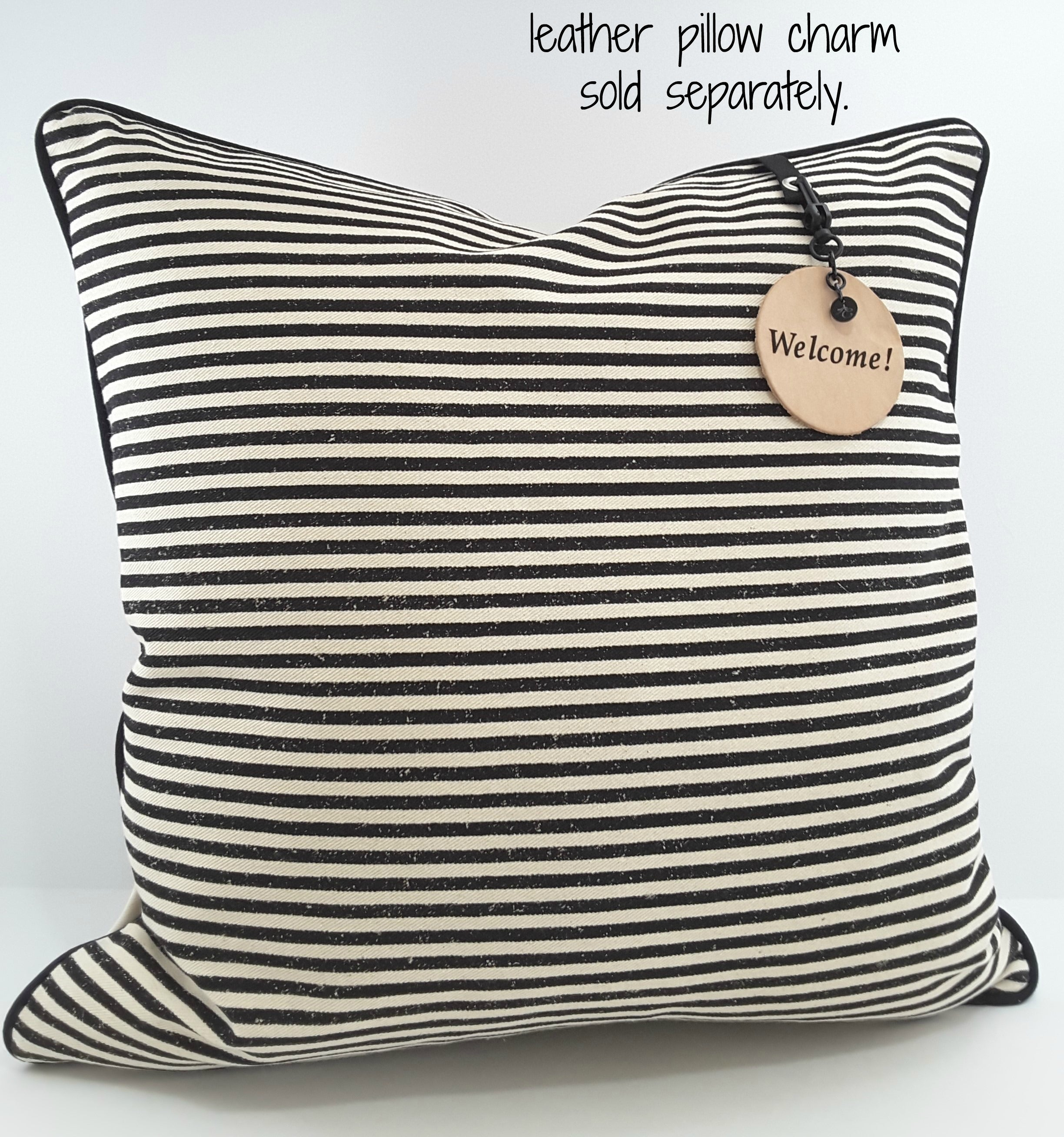 CIRCULAR LEATHER PILLOW TAG on stripe pillow
