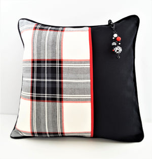 3-STRAND BEADED PILLOW CHARM HANGING FROM PLAID PILLOW