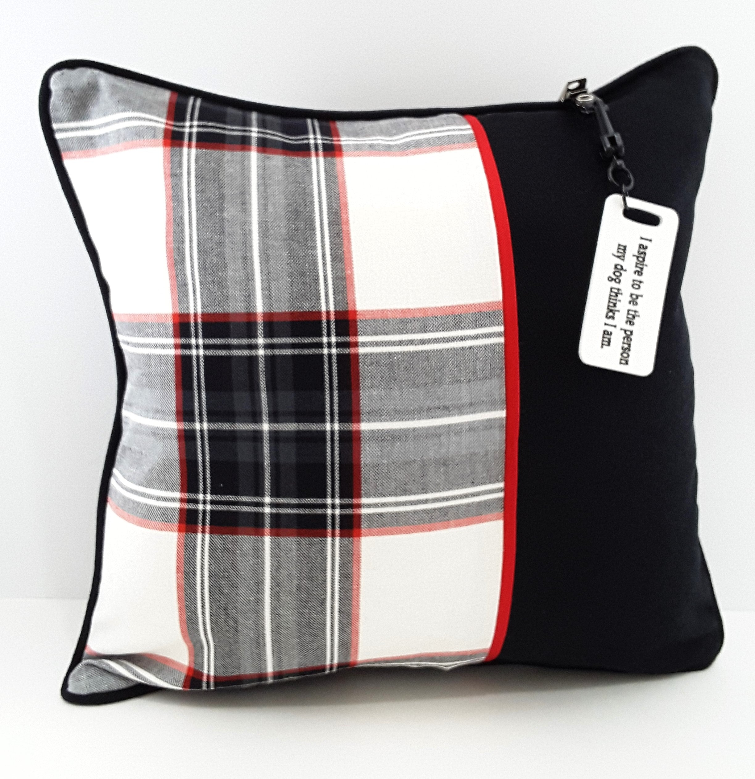 WHITE PRINTED PILLOW TAG ON PLAID PILLOW