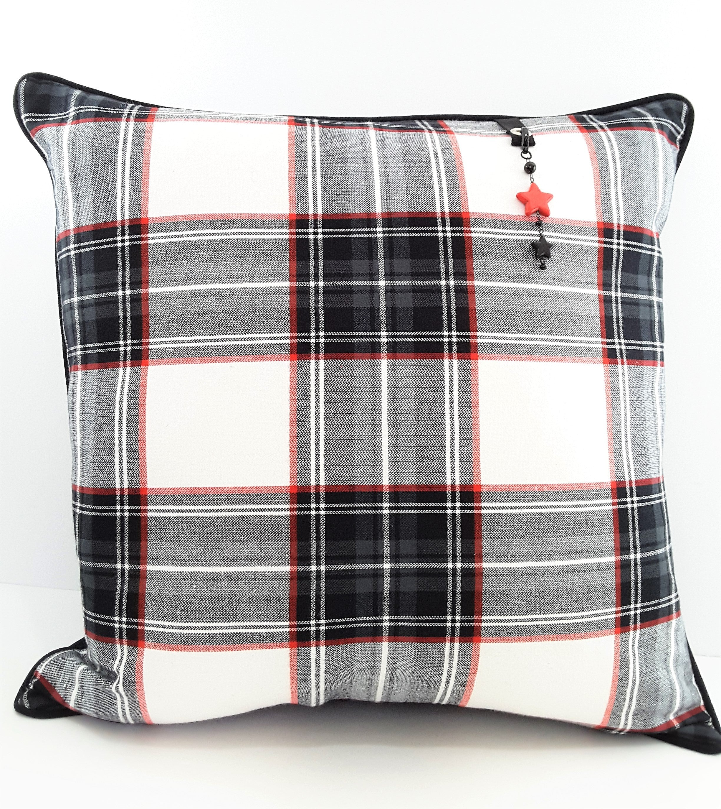 RED STAR PILLOW CHARM HANGING FROM PLAID PILLOW