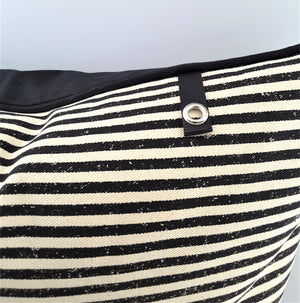 closeup of black and natural stripe pillow with tab for pillow charm