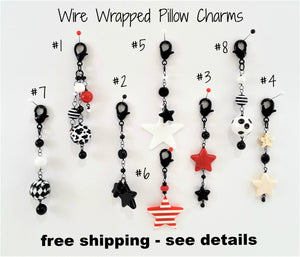 SELECTION OF WIRE-WRAPPED PILLOW CHARMS
