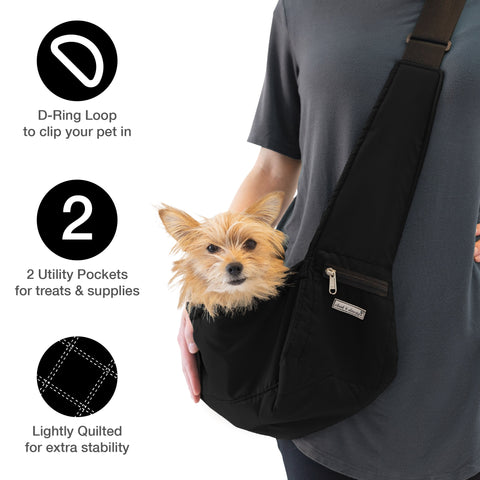 woman with tiny dog in sling carrier
