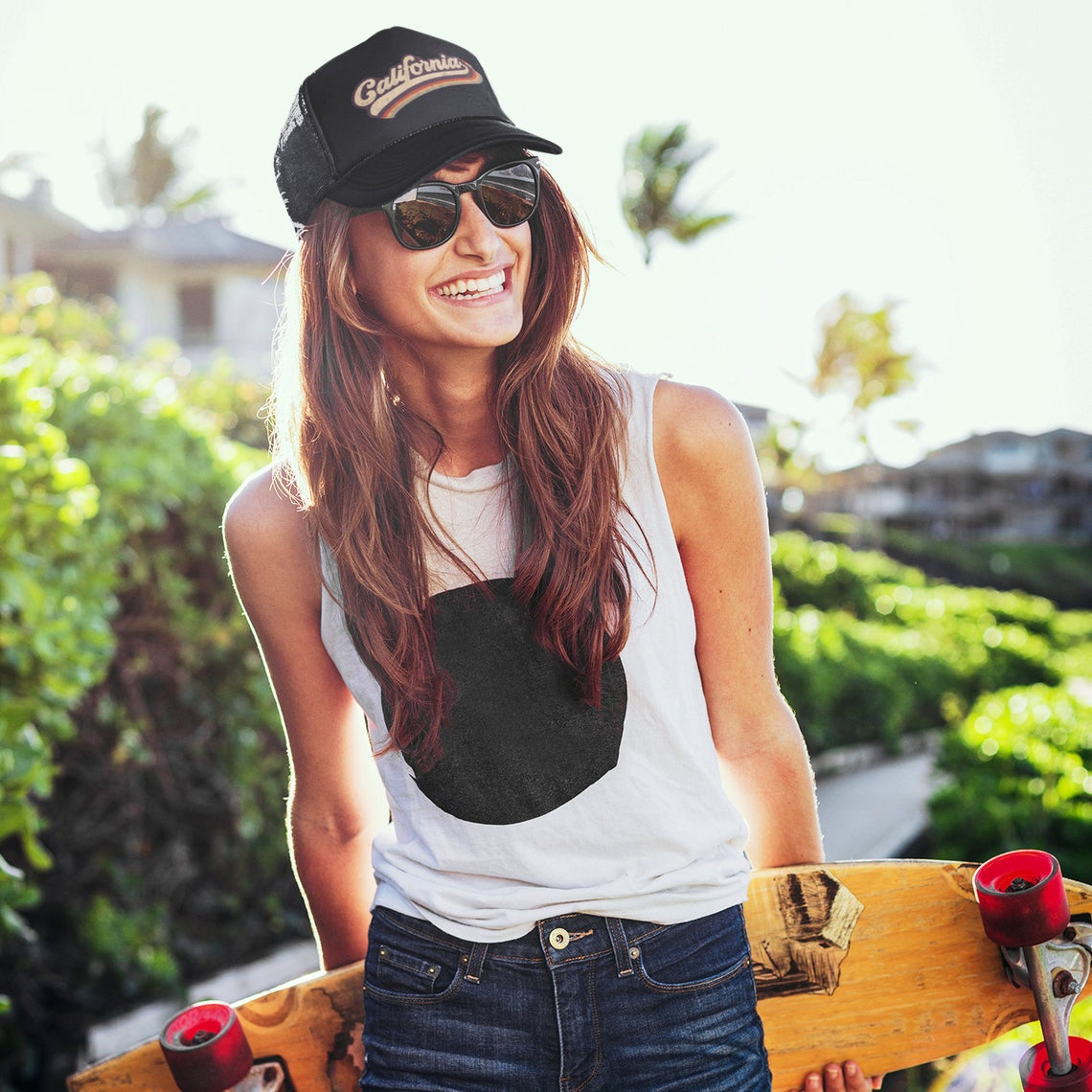 Female wearing a Black foam trucker hat with California printed in the front - DSY Lifestyle