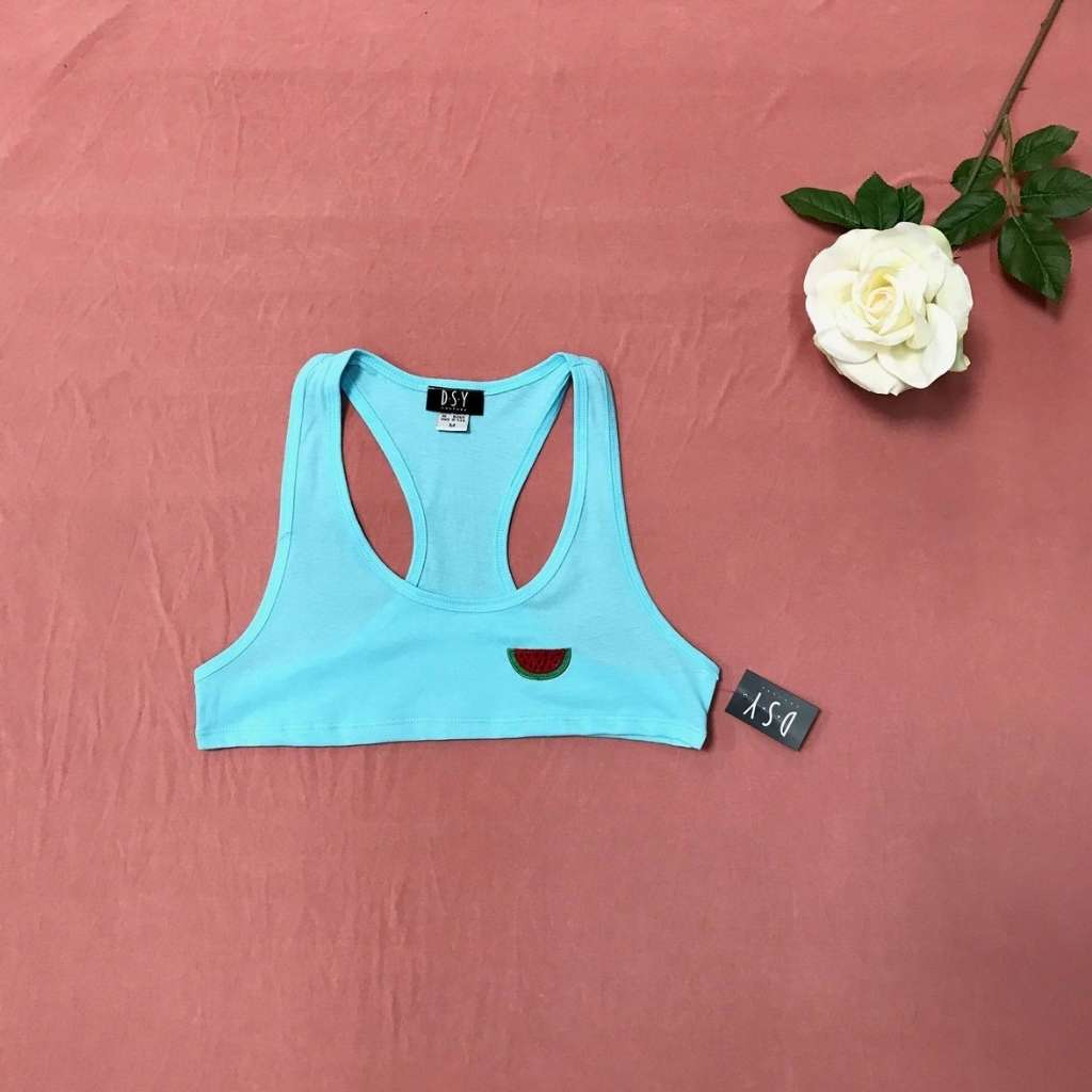 Flat lay of cancun (light blue) underboob tank top with an embroidered watermelon on the left chest side paired with jean shorts and sneakers - DSY Lifestyle