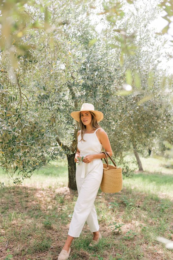 woman wearing linen clothes and raffia sandals