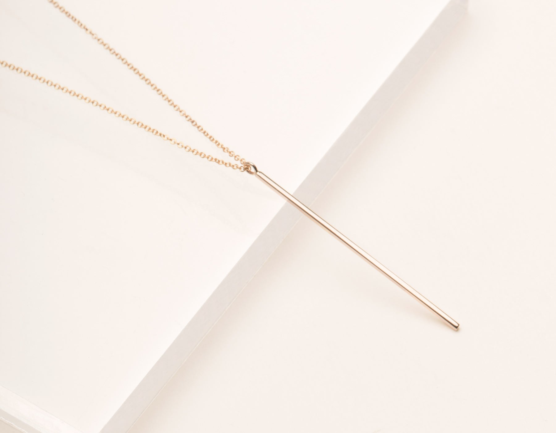 gold swift vertical necklace with bar pendant products delicate lola