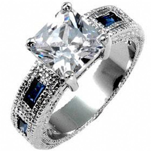 Sarah's Sapphire Blue CZ Accented Princess Cut Ring - None