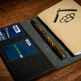 Handcrafted Notebook Wallet - Black Leather Goods Savage Gentleman. Thjis expedition wallet will hold credit cards, and a notebook. It's crafted from premium cowhide leather. Made in the USA.