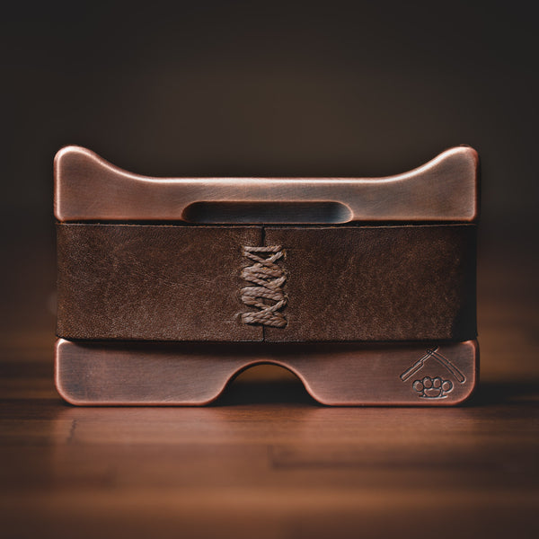 Antiqued copper minimalist wallet with hand-sewn vintage brown leather strap.