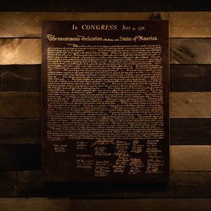 Leather Declaration of Independence hanging on a wood wall by Savage Gentleman.