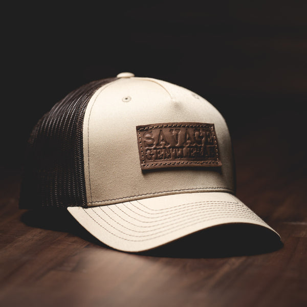 Savage Gentleman Leather Patch Trucker Hat in coffee mesh and sand.